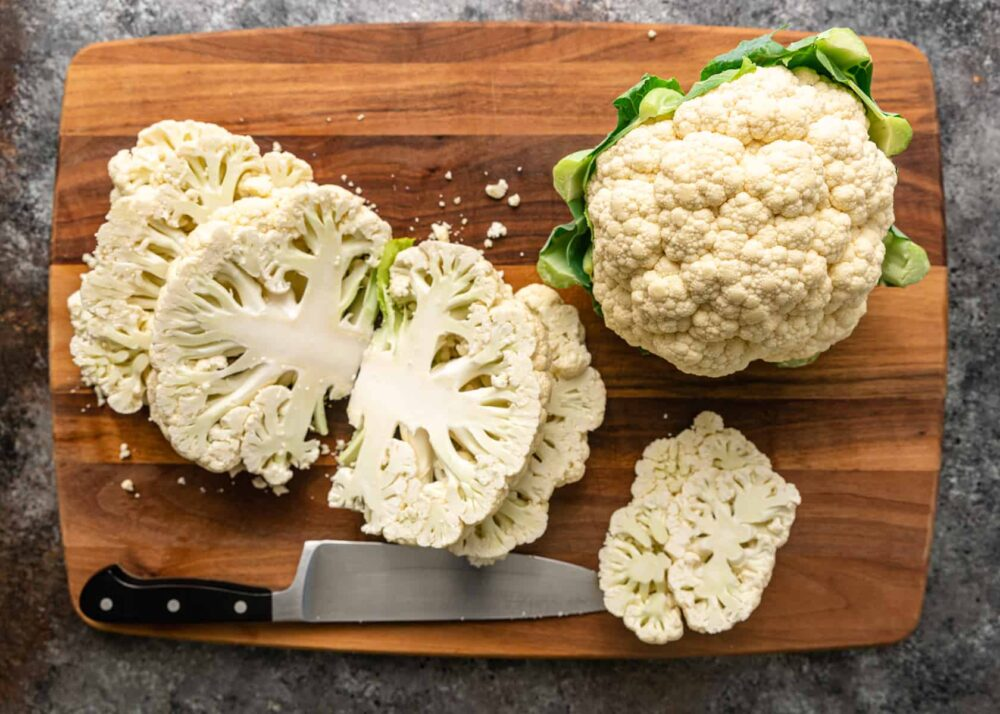 slicing raw cauliflower