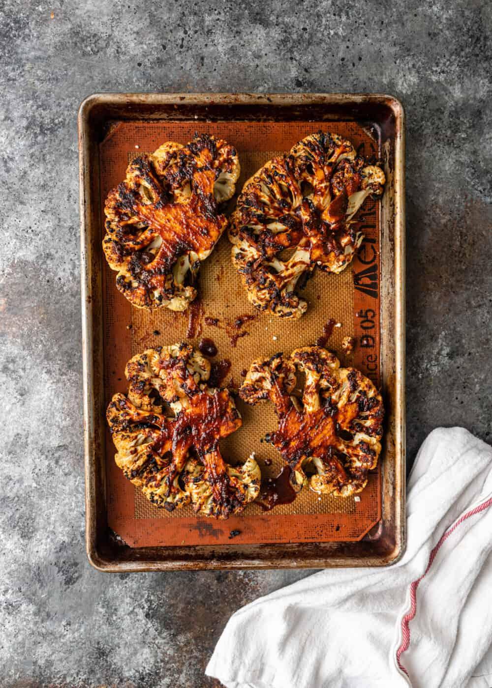 golden roasted cauliflower on baking pan