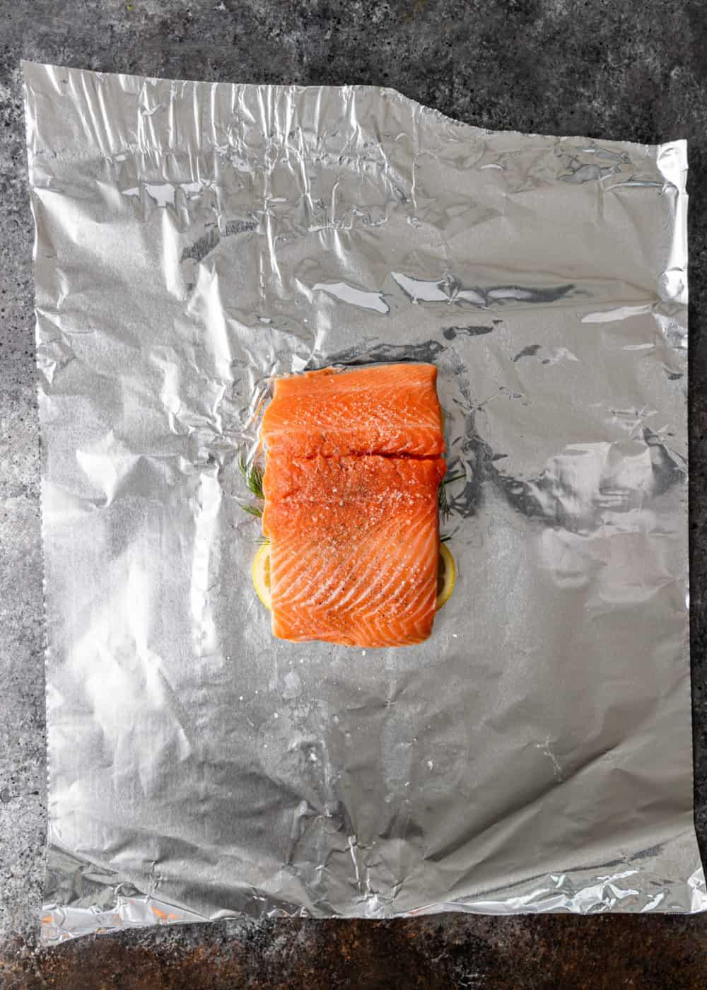 preparing wild salmon filet for grilling