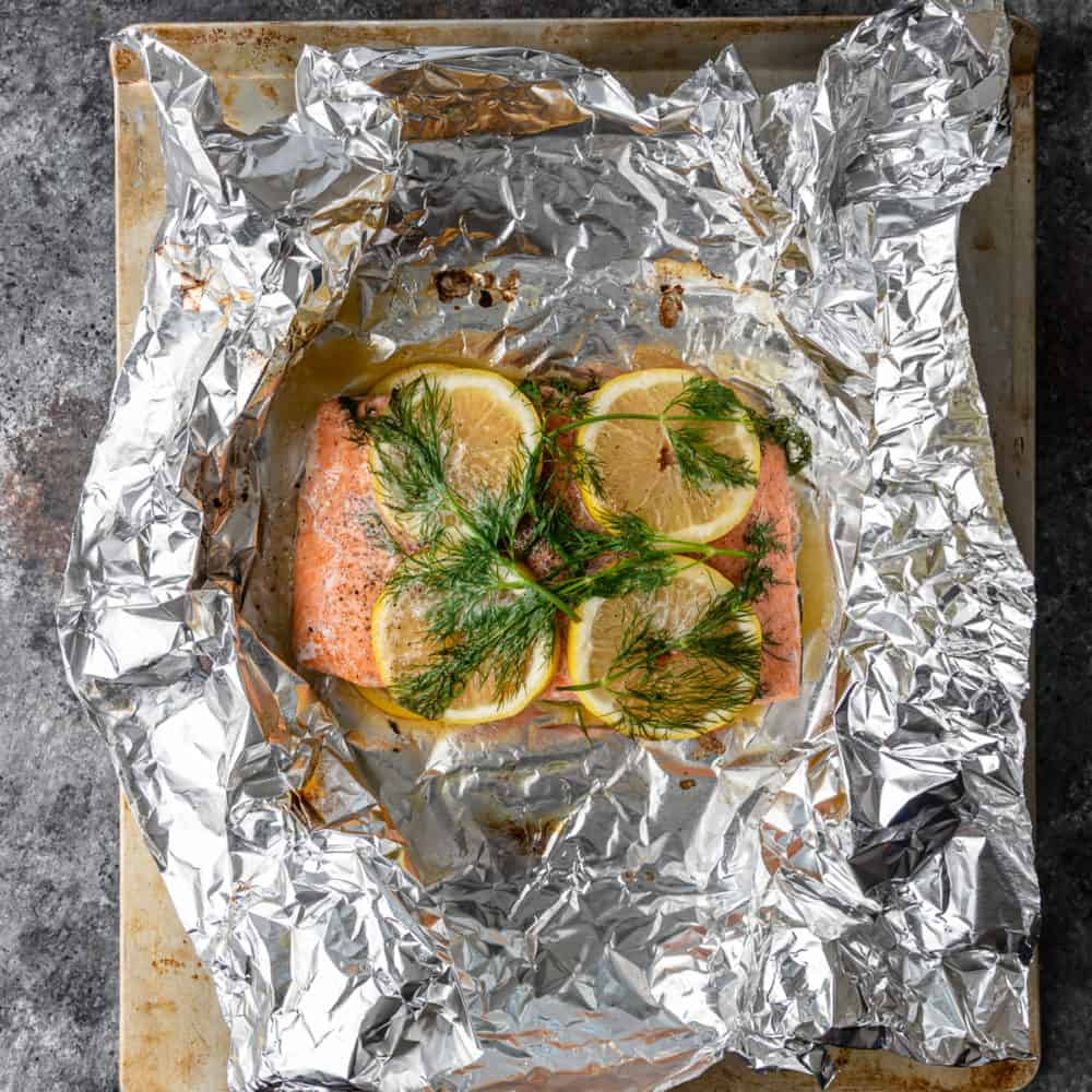 salmon topped with lemon slices and fresh dill