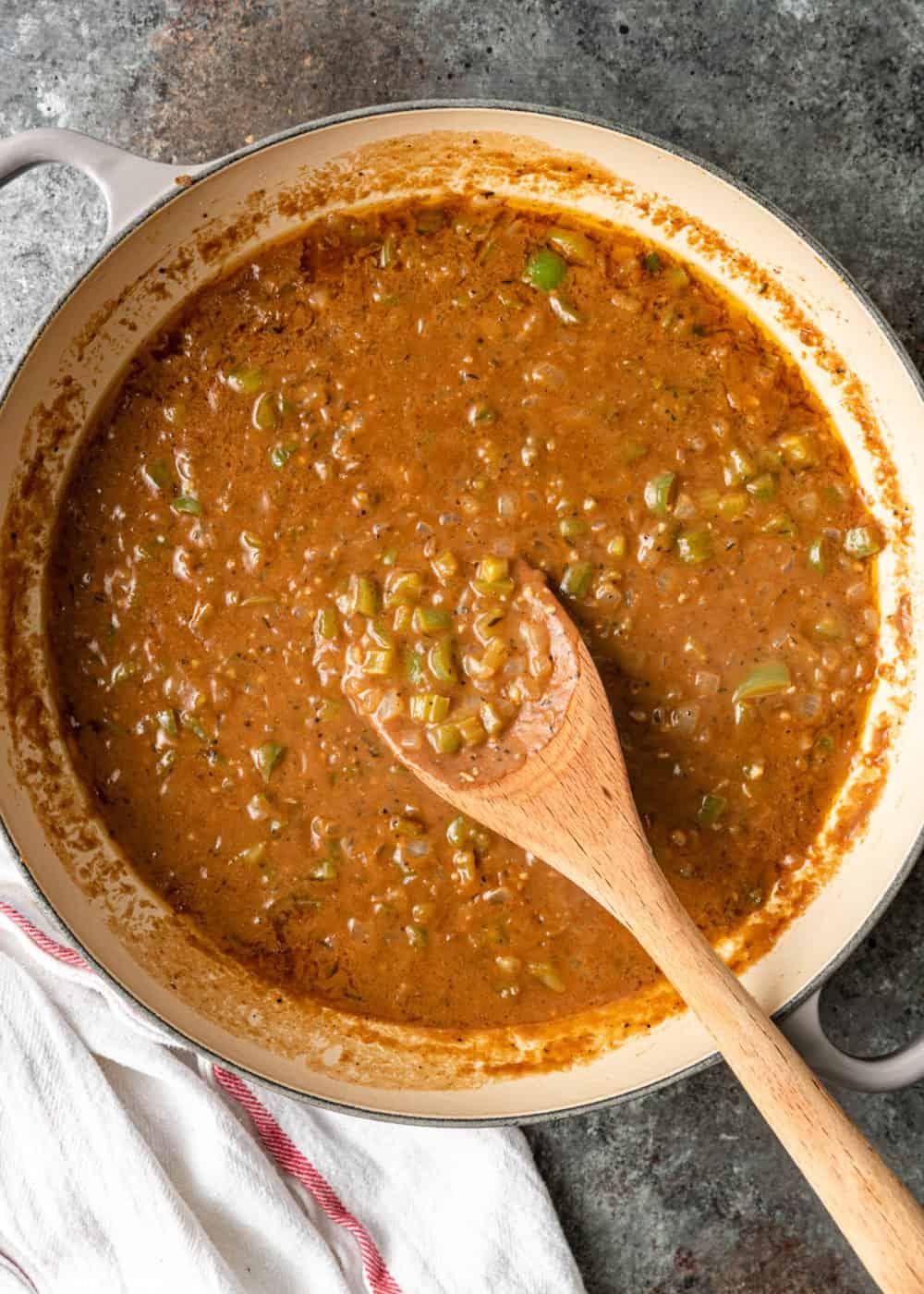overhead: pot of dark brown, thick Cajun gravy/sauce