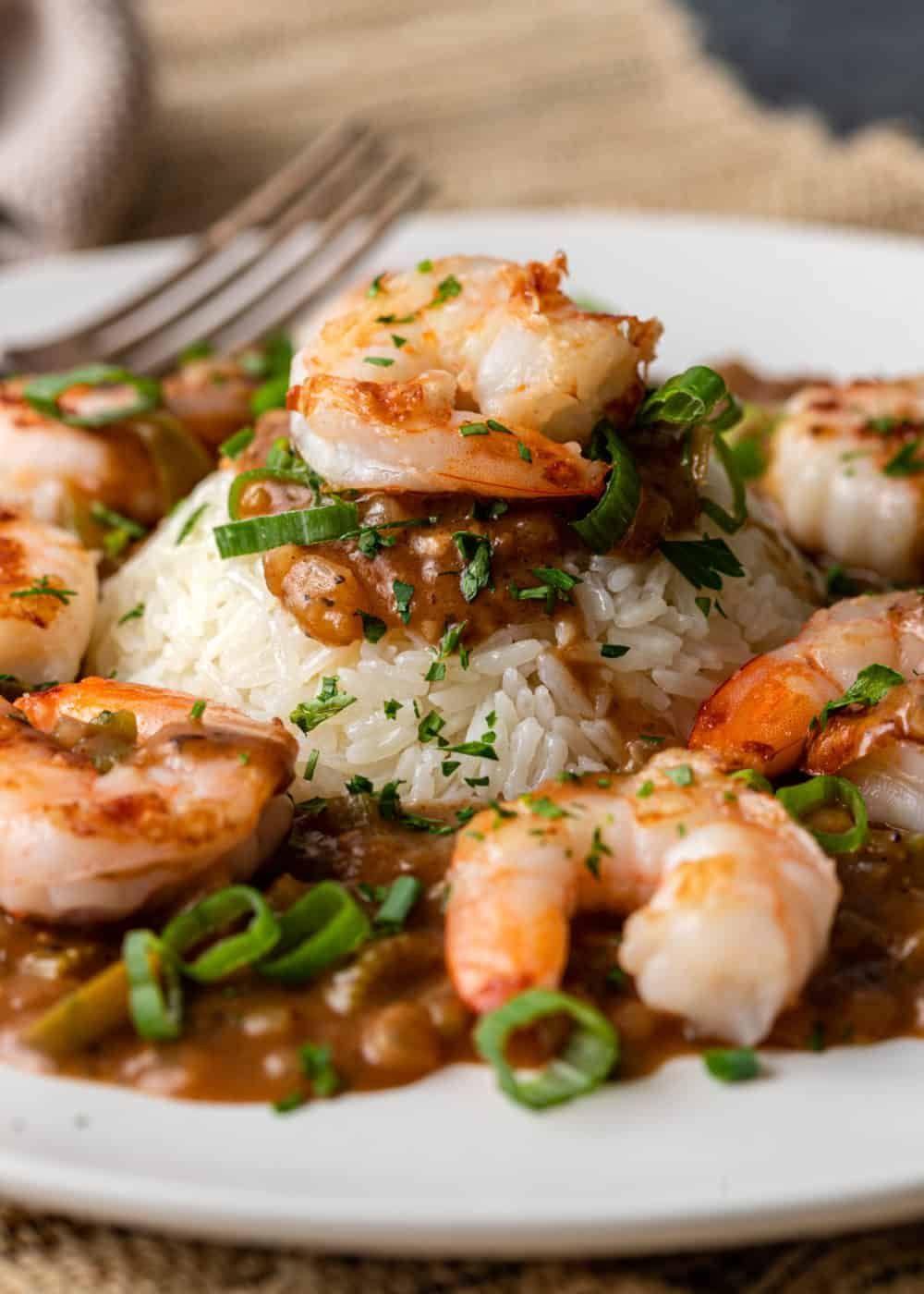 classic New Orleans shrimp dish of etouffee served on white plate