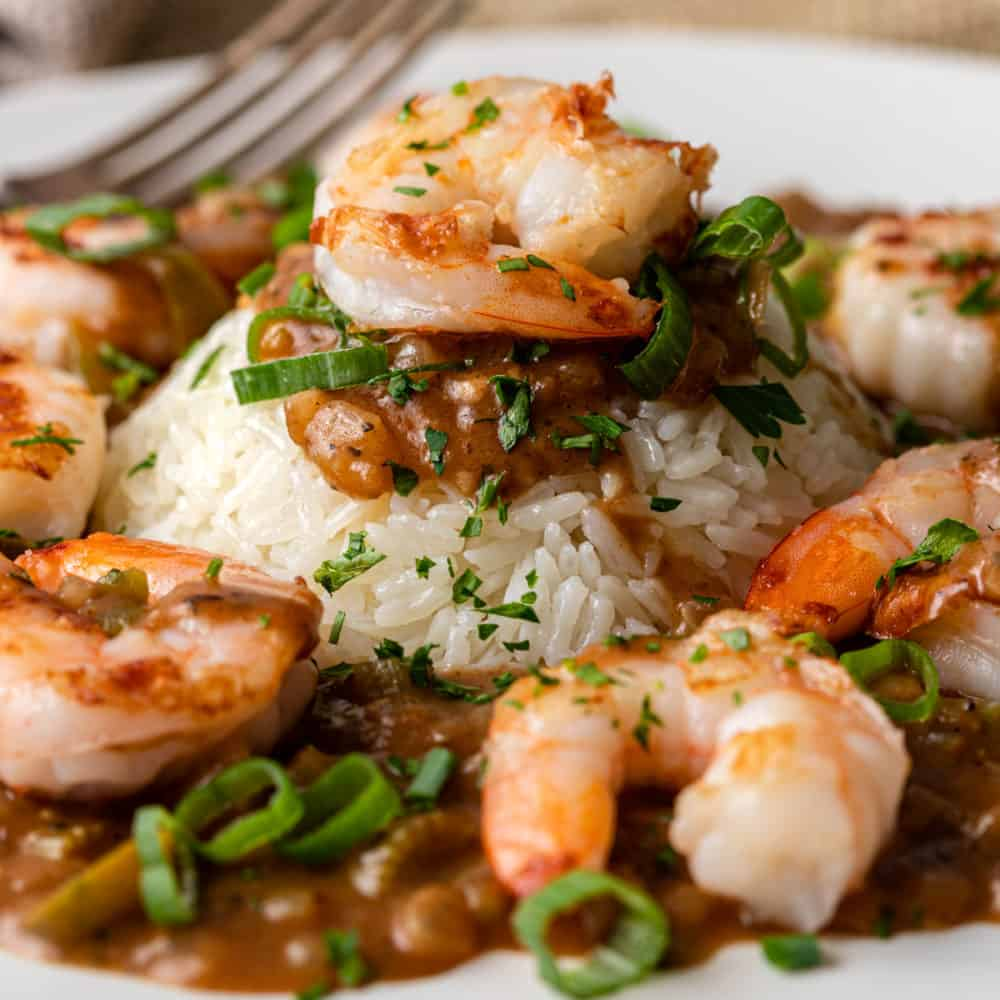close up of shrimp etouffee on bed of white rice