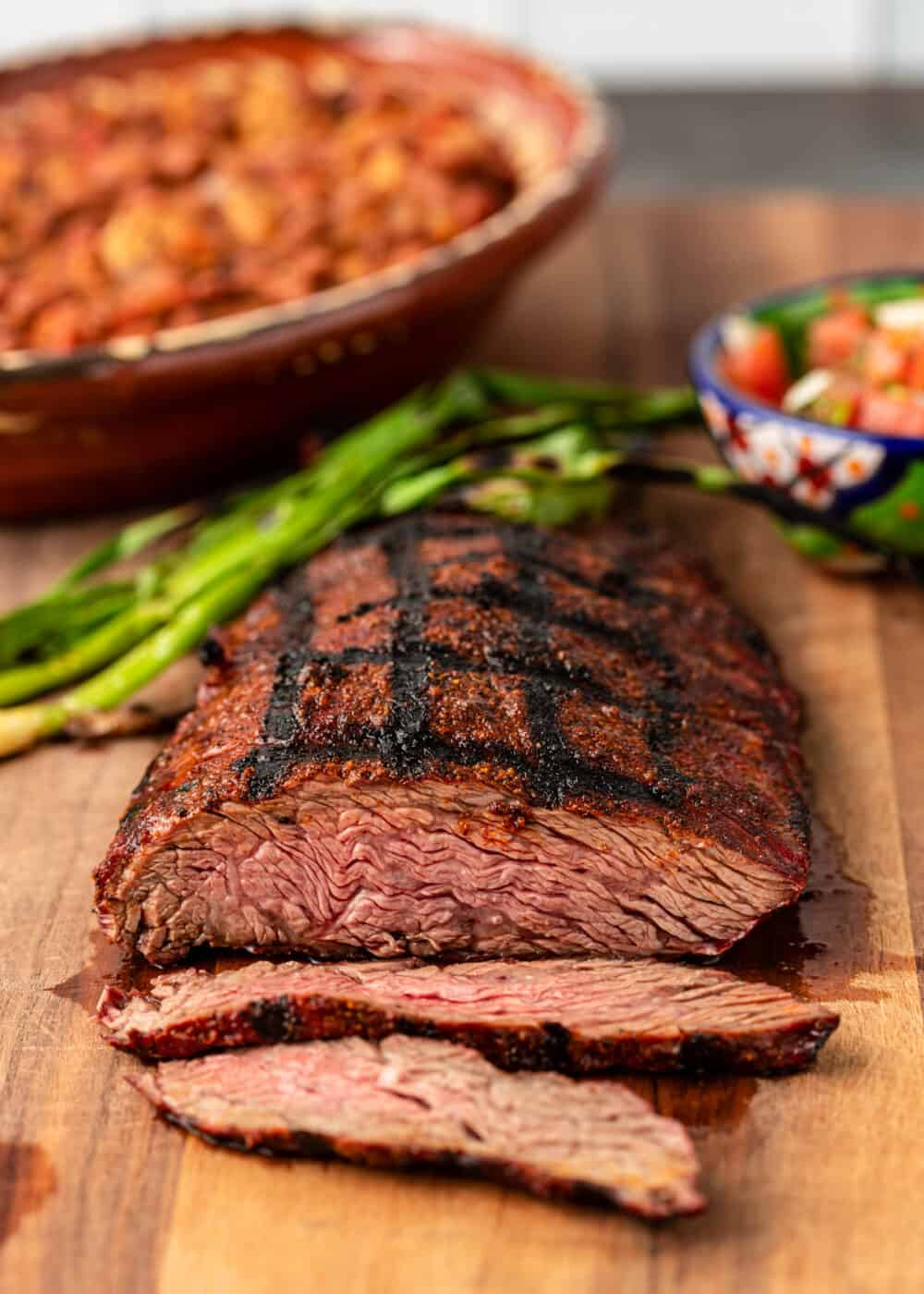 overhead image of grilled beef bavette on cutting board