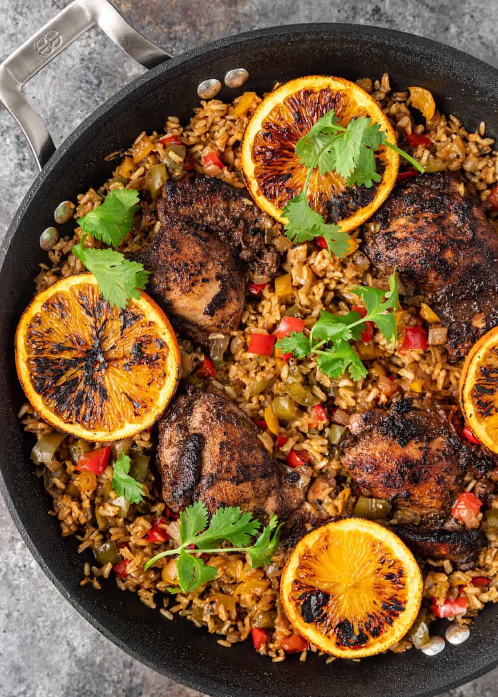 overhead: caribbean jerk chicken in black skillet