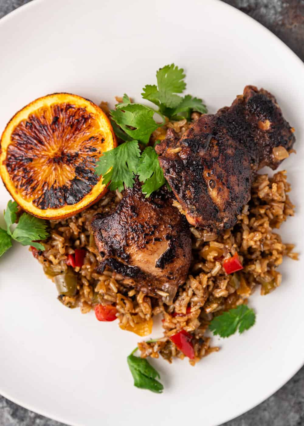 overhead image: Caribbean chicken breasts plated on bed of brown rice