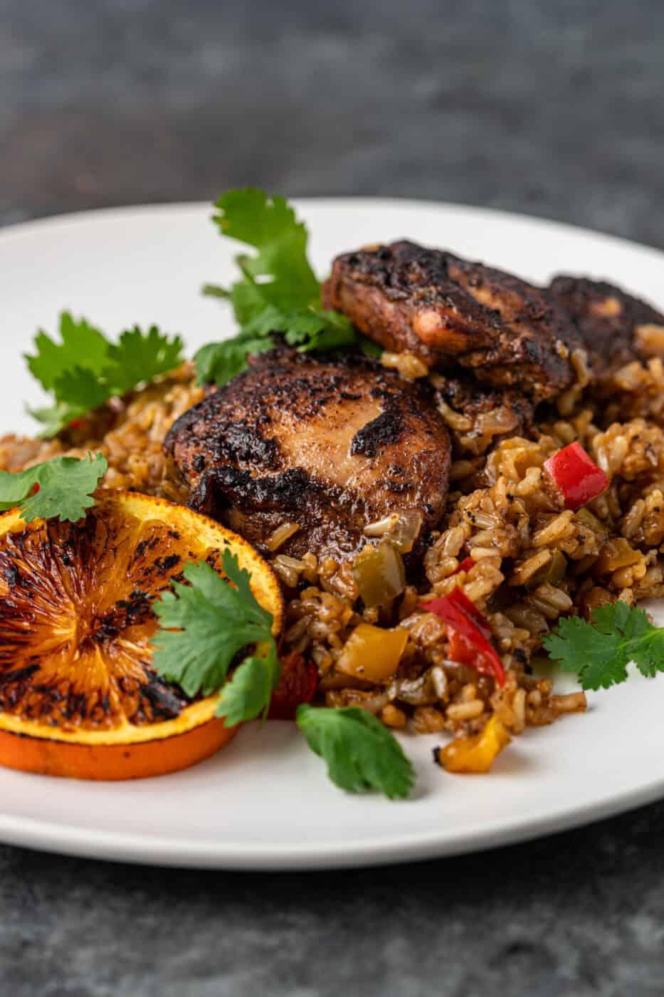 Jamaican chicken dinner on white plate