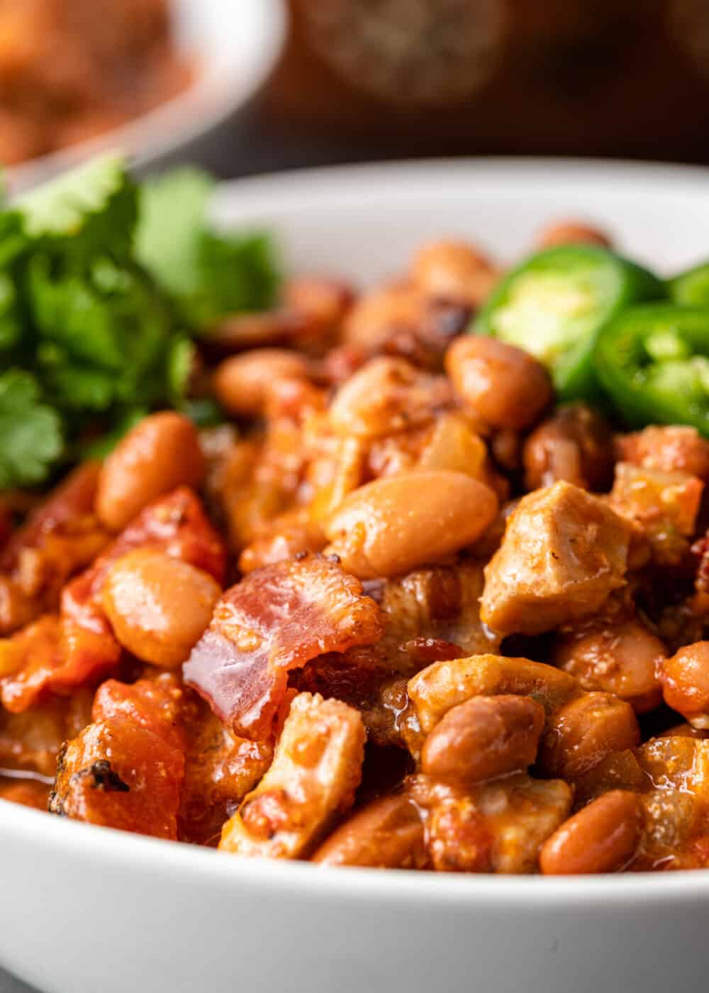 close up image of slow cooked Mexican pinto beans with bacon