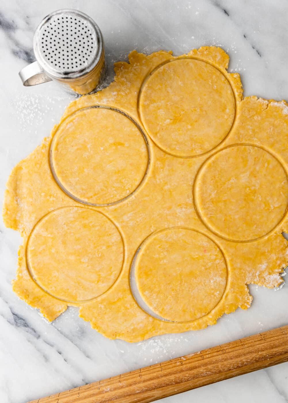 overhead: cutting empanada discs from dough