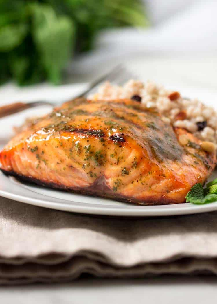grilled wild sockeye salmon with mustard sauce on white plate