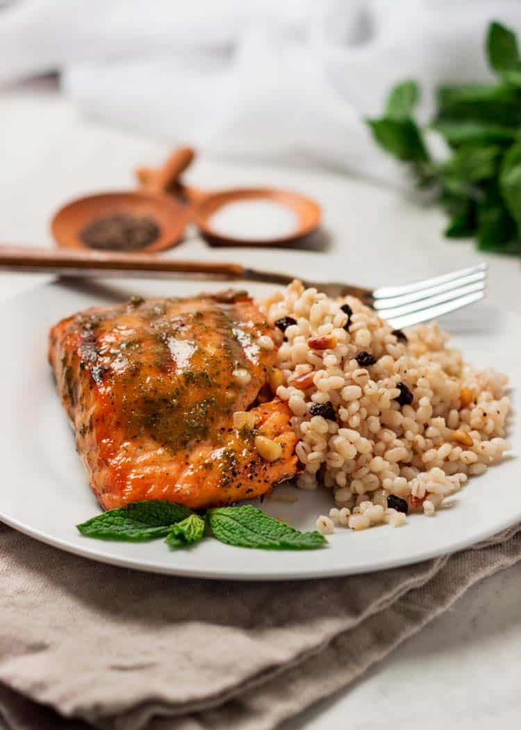 baked fish filet with side of couscous on white plate
