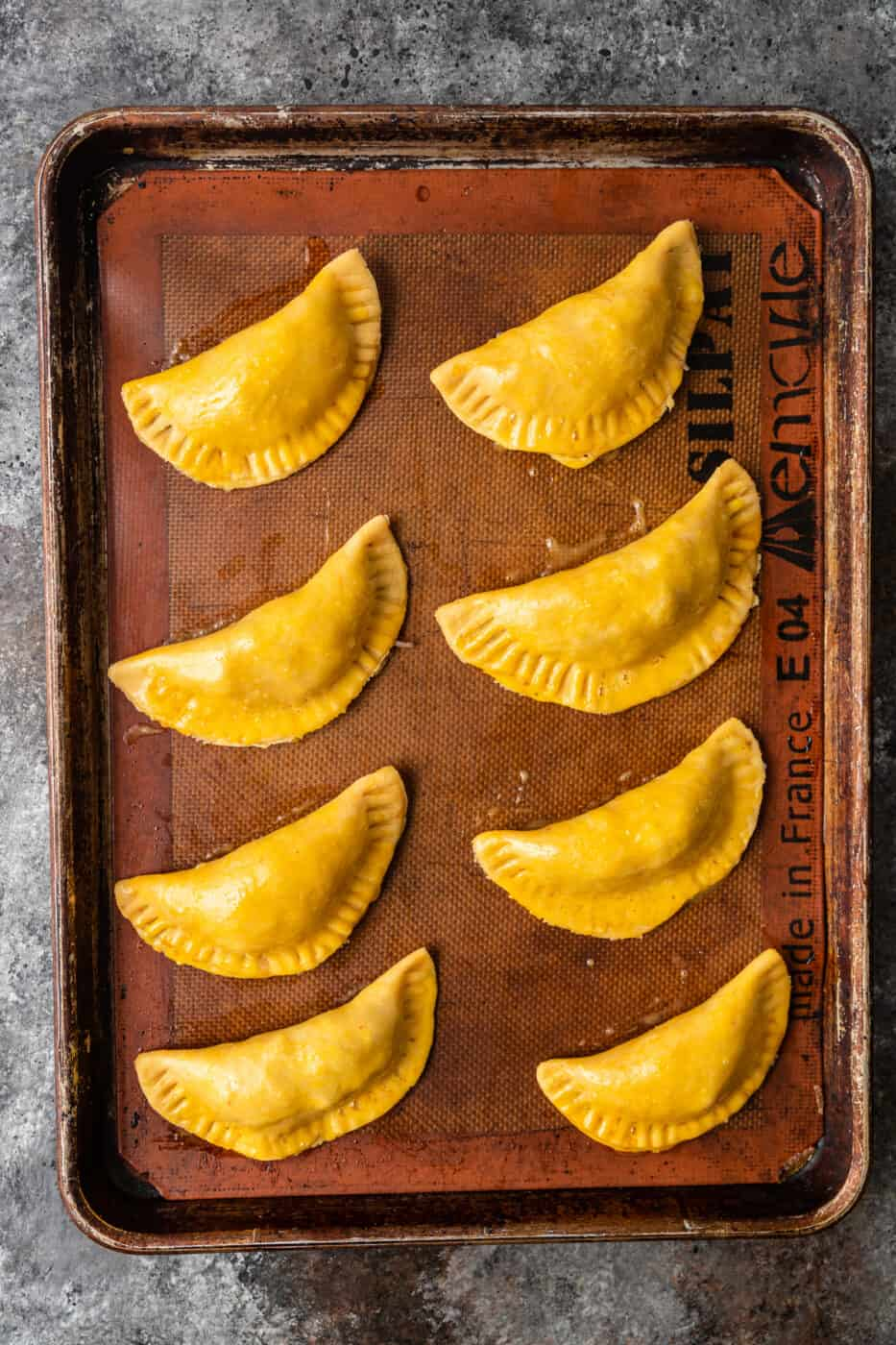 unbaked mexican hand pies on baking sheet