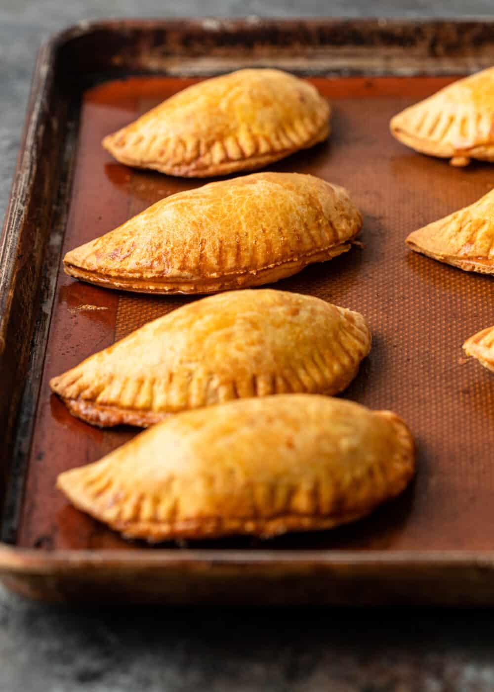 baked empanadas on baking sheet