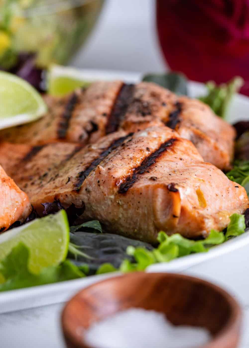close up image of mango salsa salmon on serving platter