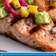 titled image for Pinterest shows mango salsa on top of salmon on the grill