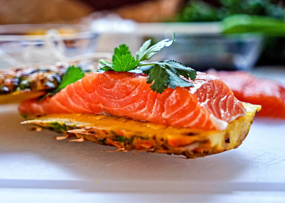 close up image of pineapple salmon before grilling