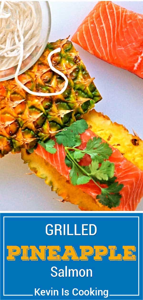 titled image for Pinterest shows salmon filet on top of pineapple planks, ready for grilling