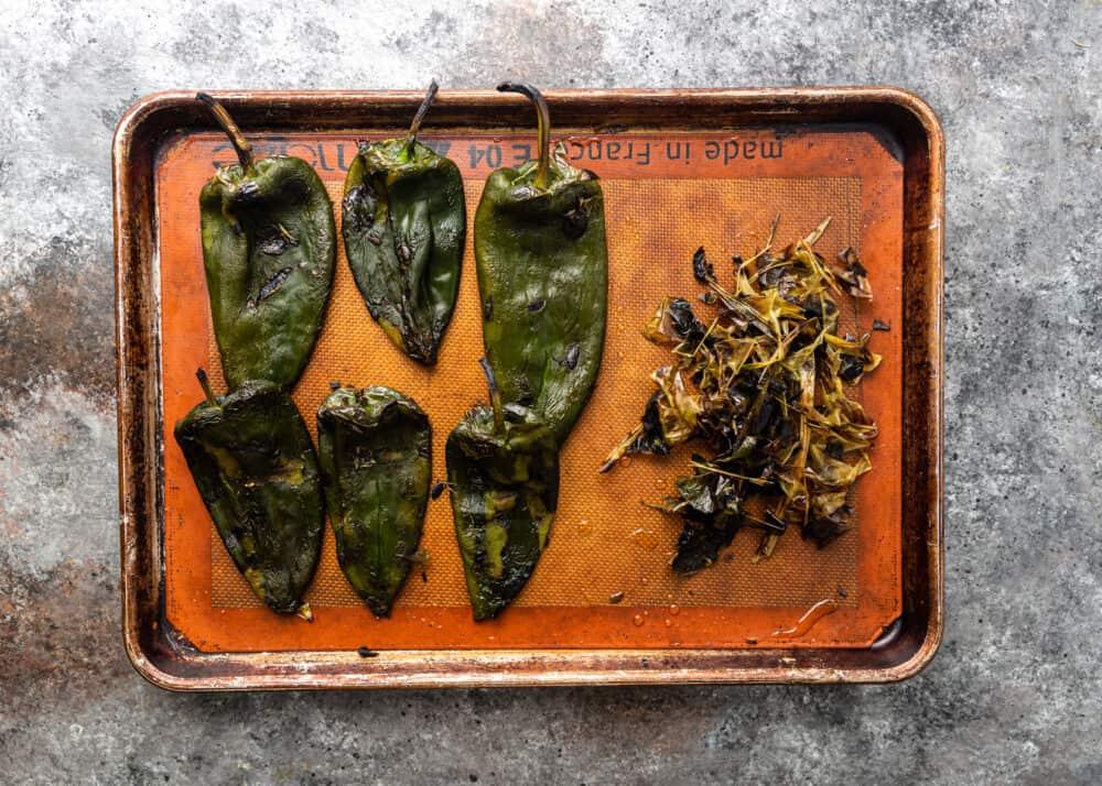 overhead image: roasting poblano peppers on baking sheet