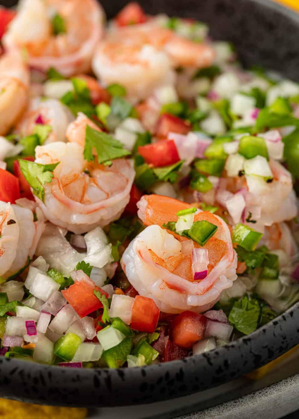 fresh shrimp appetizer in bowl with pico de gallo