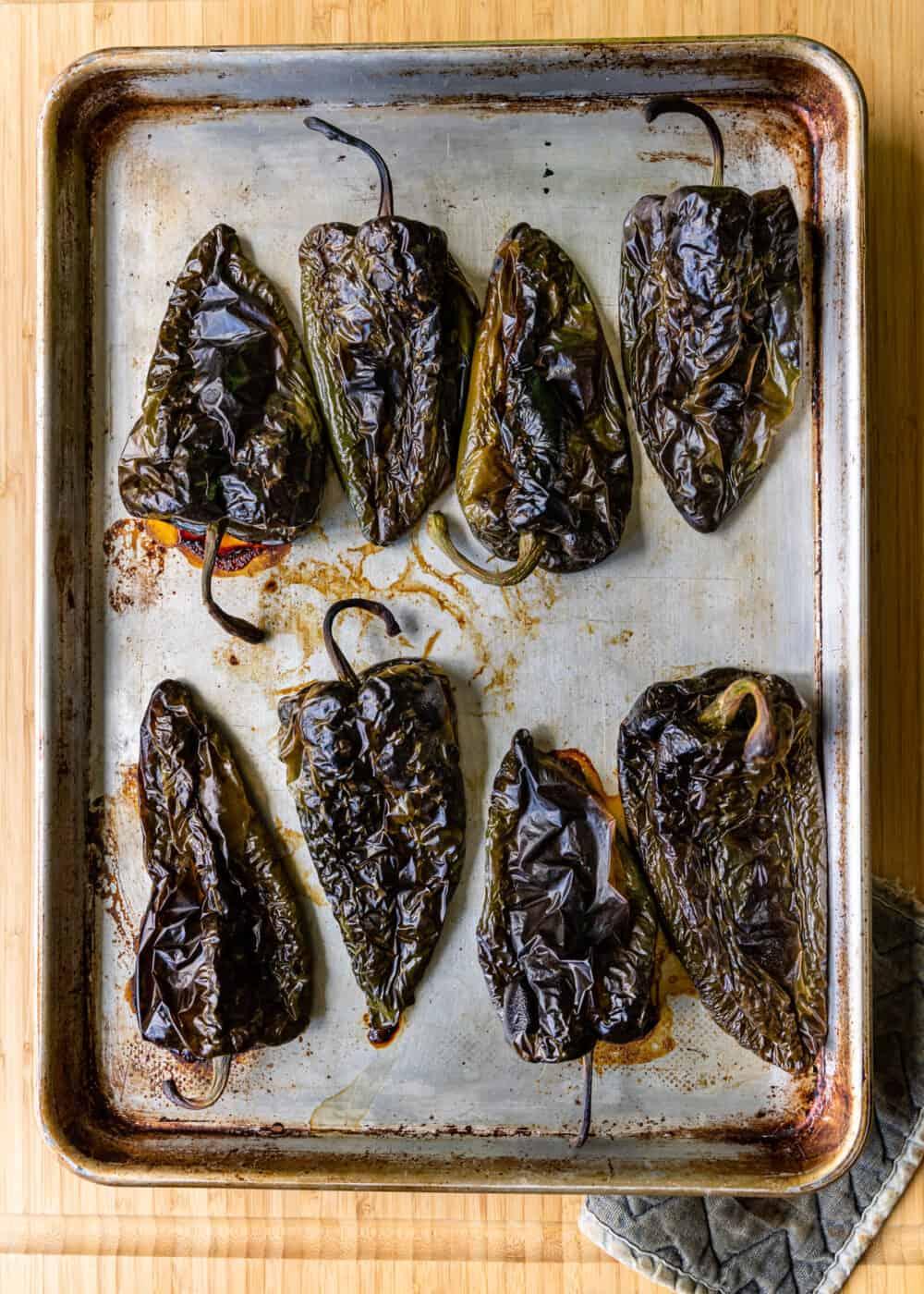 roasted poblanos on baking sheet