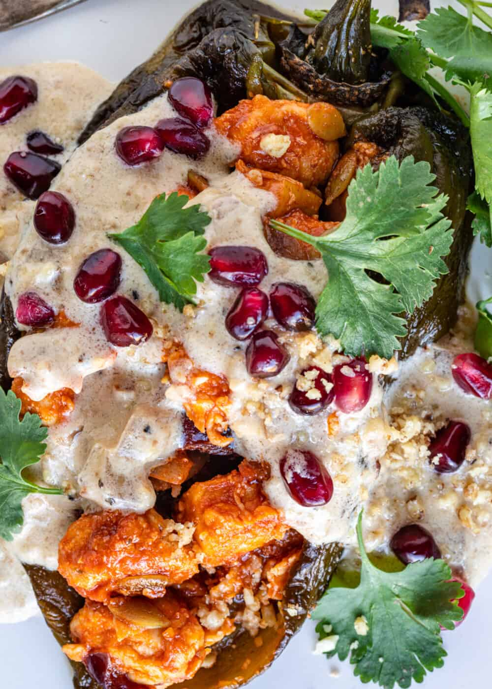 roasted chiles stuffed with chicken, fruit and vegetables, covered in walnut sauce