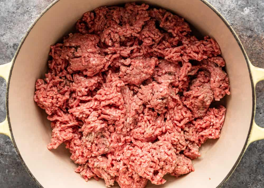 overhead: uncooked ground beef in large pot