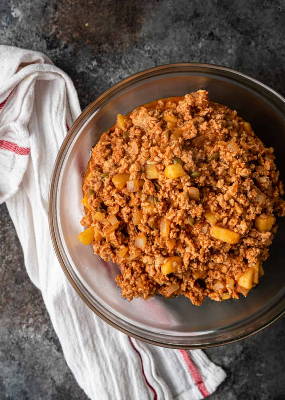 overhead: bowl with spicy ground chicken mixture for stuffed peppers