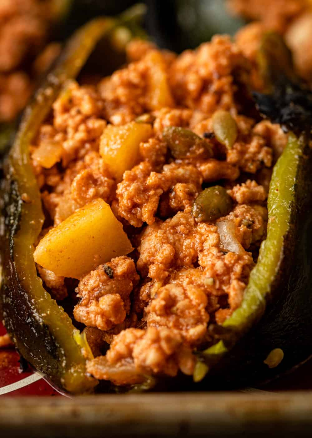 closeup: ground chicken and apple filling in stuffed green peppers
