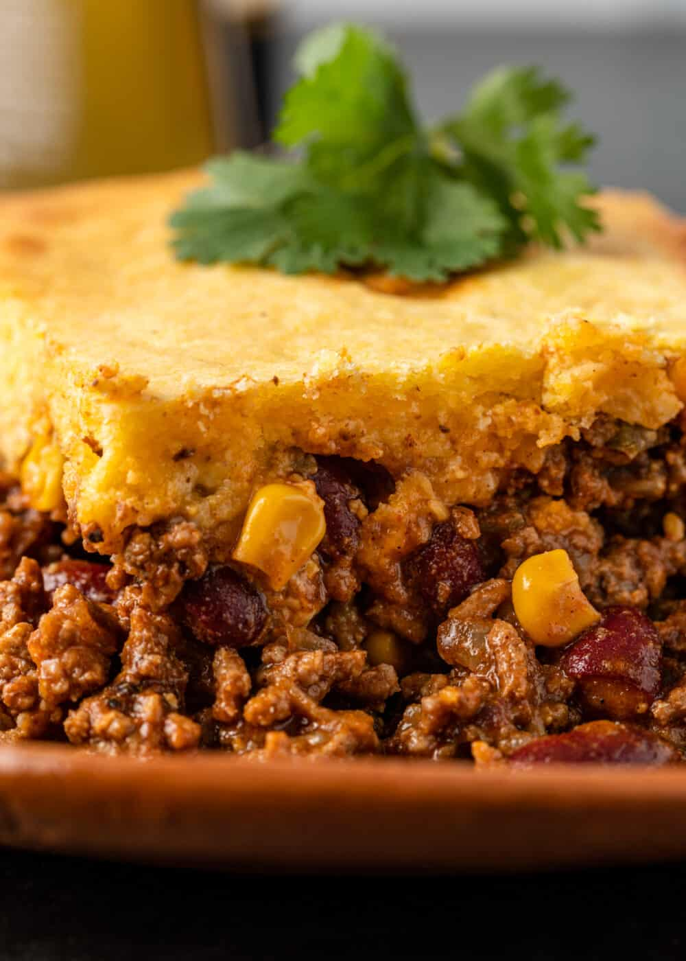 close up: tex mex dinner bake with ground beef, corn, kidney beans and cornbread topping