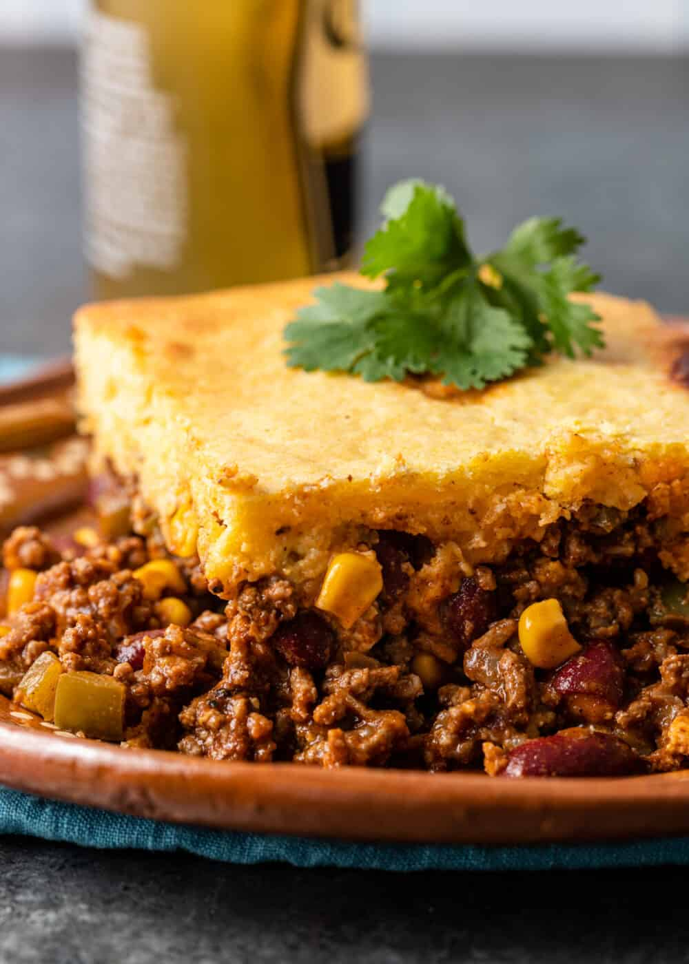 side view: serving of tamale casserole on brown plate