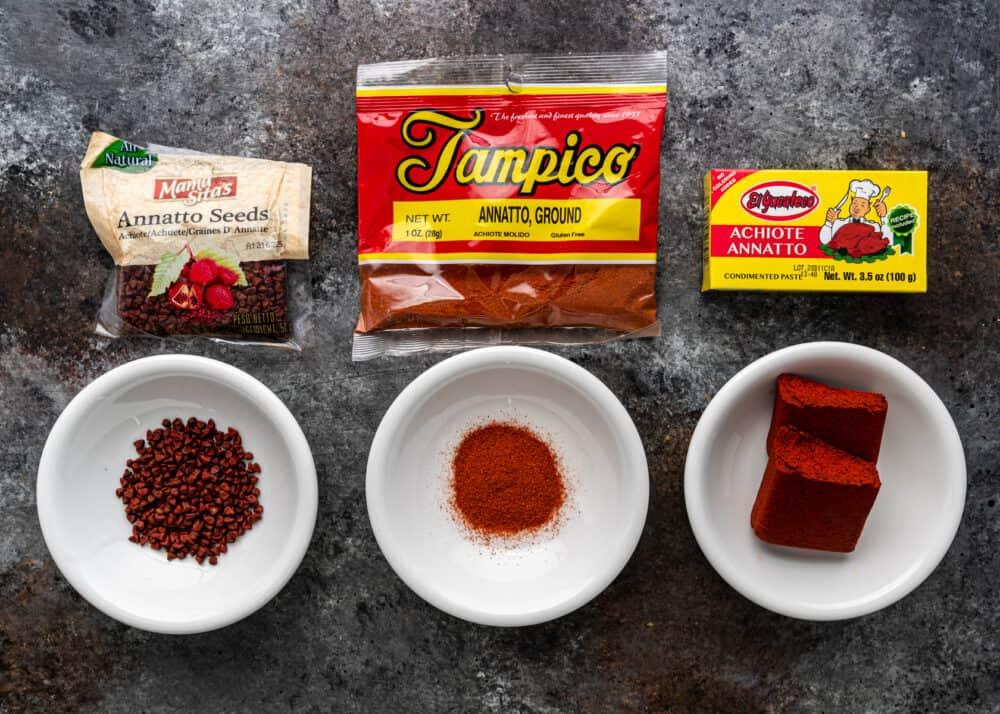 annatto seeds, ground annatto and achiote paste in white bowls
