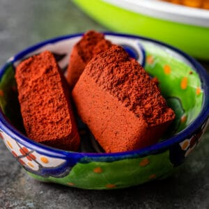 achiote paste broken into piece sin small bowl
