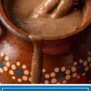 titled image: mug of chocolate atole with drip running down side