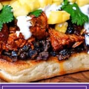 titled image: pork sandwich on ciabatta roll with crema, black beans and pineapple chunks