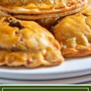 tex mex baked hand pies stacked on white plate
