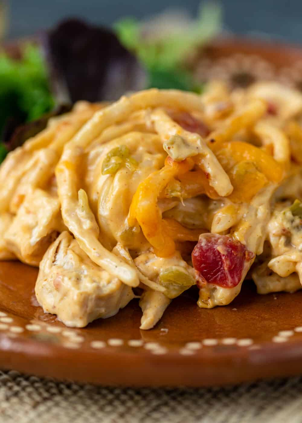 close up: serving of shredded rotisserie chicken spaghetti on plate