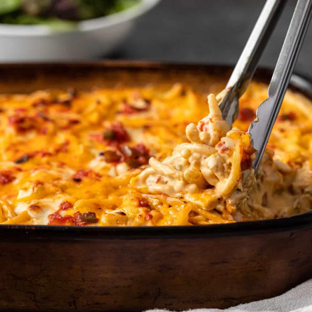 close up show of tex mex chicken spaghetti in casserole dish