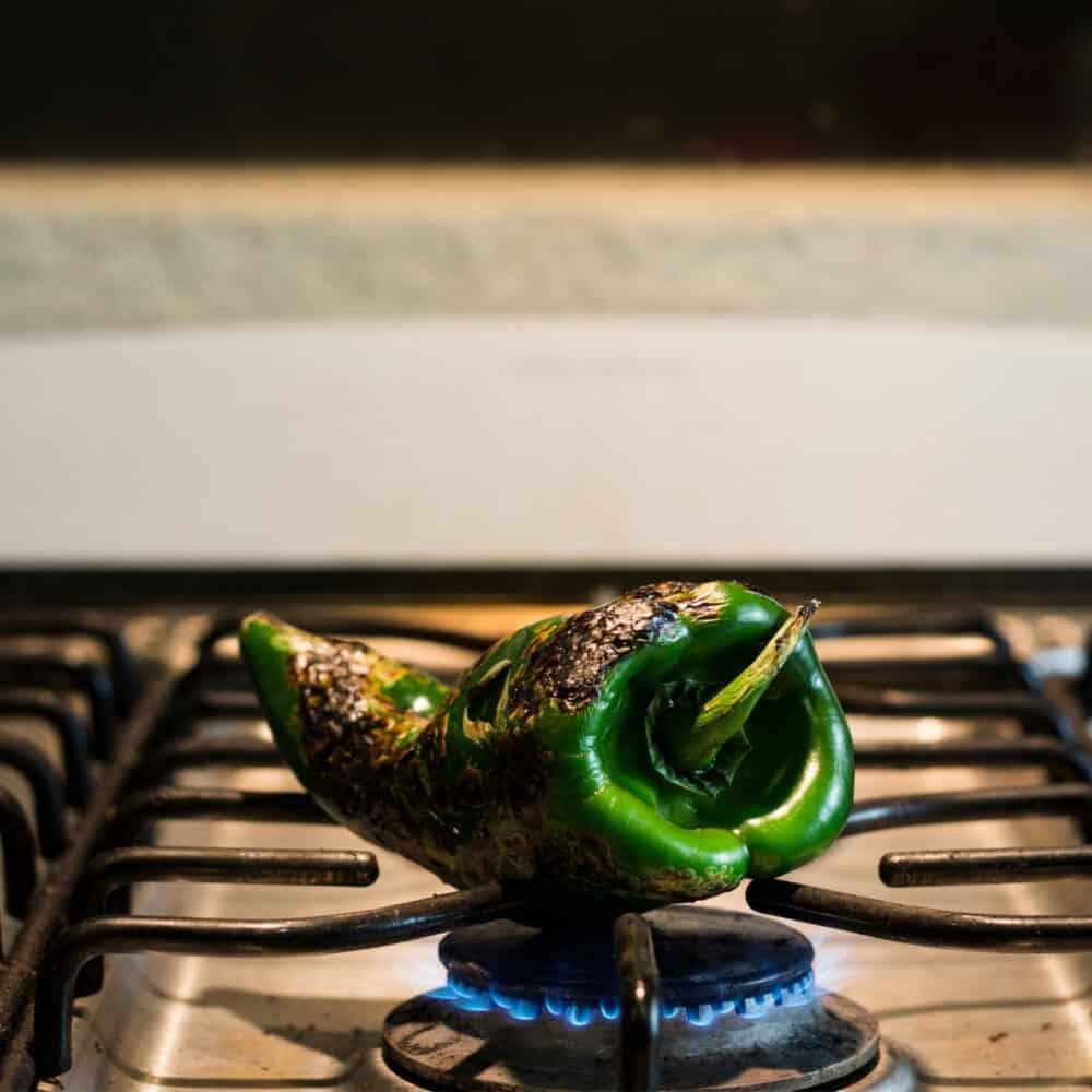 roasting poblano chile over gas flame